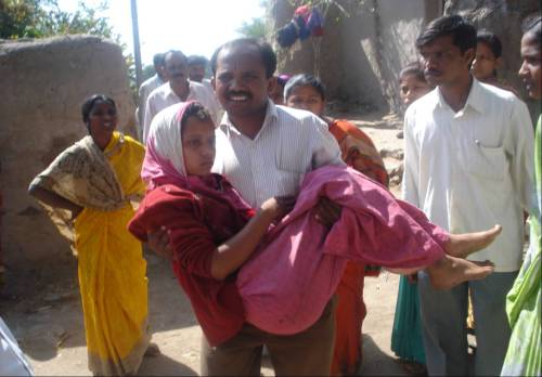 18 year old Diksha Shinde being taken to hospital by her brother