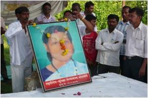 Pic3 Bhaiyalal Bhotmange garlanding late Surekha Bhotmabge's picture
